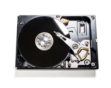 formatting: the computers hard drive is shot isolated on white background Stock Photo