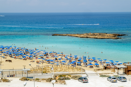 May 24, 2016.Protaras.Chairs with umbrellas on the beach in Fig tree Bay in Protaras .Cyprus.