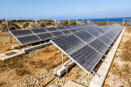 moveable: Rows of solar panels on the Sunny sea coast on a hot summer day
