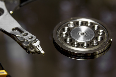 The hard drive from the computer disassembled, photographed close up
