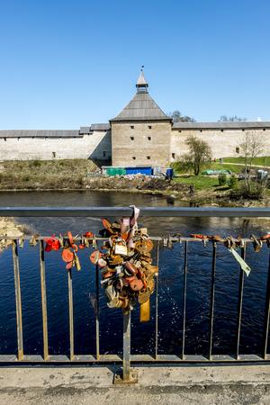 leningradskaya: Staraya Ladoga.Russia.02 may 2016. Locks hung on the railing of the bridge opposite the fortress in Staraya Ladoga. Editorial