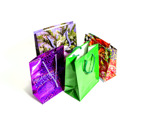 Several colorful gift bags isolated on white background