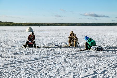 Kavgolovo.Russia.22 Jan 2017.Fishermen catch fish on the ice of lake Khepoyarvi in Kavgolovo Leningrad oblast Editorial
