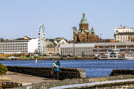 Helsinki. Finland.April 7, 2018.Holy Orthodox Uspensky Cathedral and Ferris wheel in Helsinki.Finland. Editorial