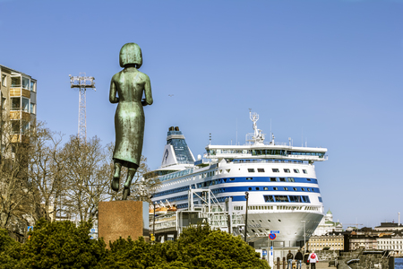 Helsinki. Finland.April 7, 2018.View of the cruise ferry and the Monument of peace between Finland and the USSR in Helsinki.
