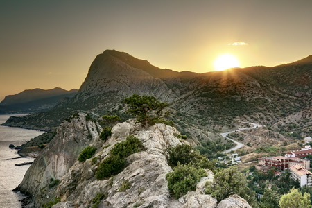Crimea. Ukraine. August 26, 2011. View of the mountains and the coast of Crimea in Sudak at sunset Editorial