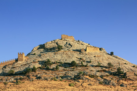 View of the Genoese fortress in Sudak at sunset