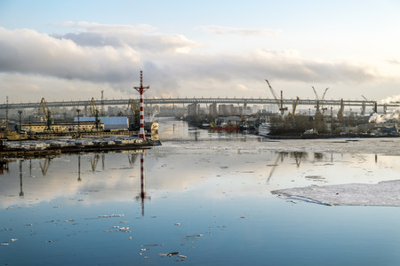 Cranes and ships in the marine cargo port of Saint-Petersburg