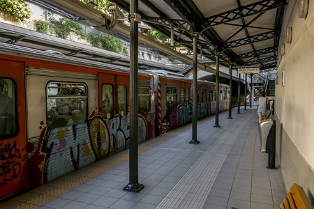 Athens.Greece.May 31, 2019.Train with graffiti at the Monastiraki metro station Platform in Athens.