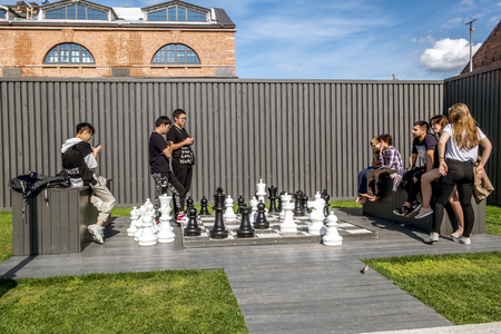 Saint-Petersburg.Russia.July 16, 2019.People play chess on the Island of