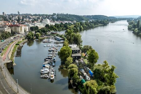 Prague.Czech Republic.August 28, 2019 . View from the height of the Visegrad district in Prague of the Vltava river, the yacht club and the city. Archivio Fotografico - 139609111