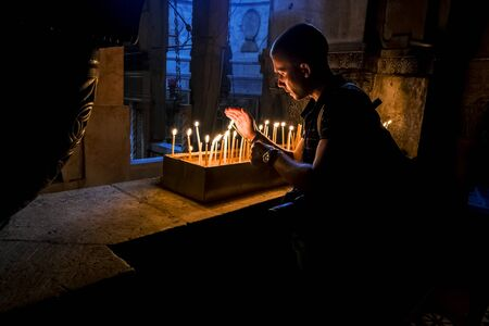 Jerusalem. Israel .11 september 2014.The pilgrims lit candles at the Church of the Holy Sepulchre in Jerusalem.