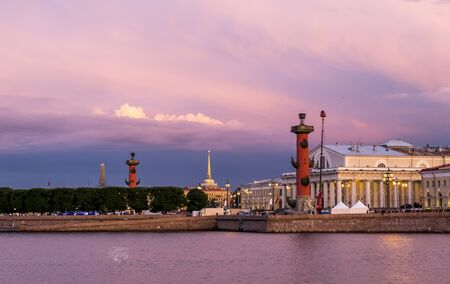 Petersburg.Russia.21 june 2014.Rostral columns lit by illumination of the white nights at dawn.