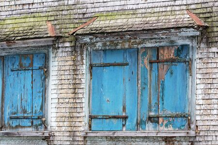 degenerated: An old shutter on a house in Appenzell Switzerland Stock Photo