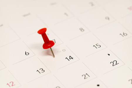 important date: Pushpin on  calendar  for important date.