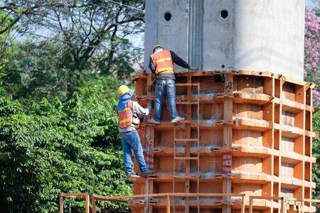 Worker at construction site,Bangkok,Thailand. Stock Photo