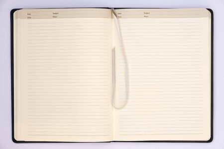 memo pad: Open page of grey notebook with ribbon and white background. Stock Photo