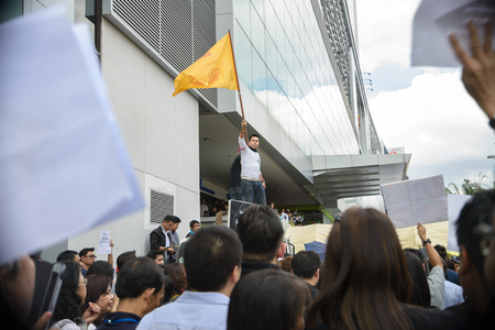 amnesty: Thai Protester is waving a royal flag in a peaceful march against government amnesty bill in Rama 9, Bangkok on November 6, 2013