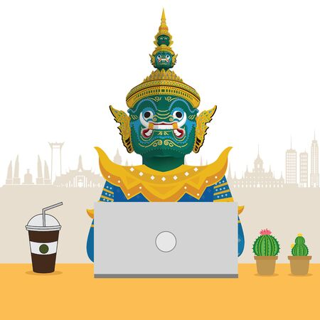 Guardian Giant of Thailand with working on his laptop