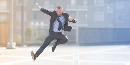 Dynamic businessman jumping outdoor in the city