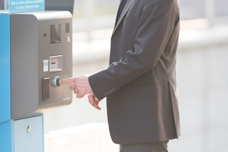 parking ticket: Businessman and a parking ticket pay machine, modern life concepts Stock Photo