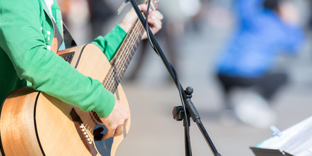 guy playing guitar: Guy playing guitar outdoor in the street, urban concepts