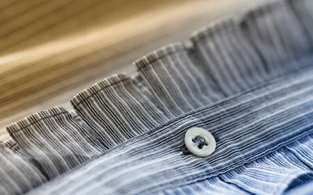 industria textil: Elegant cotton shirt macro photo, textile industry background Foto de archivo