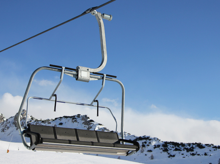 chair on the lift: Chair lift in a sunny winter day