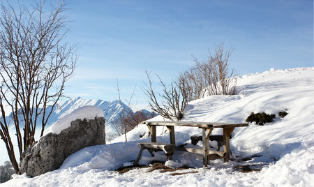 snow break: Wooden table in a winter holiday resort