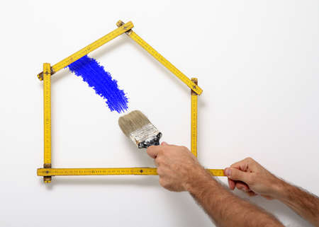 home decorating: Professional painter decorating the home, white background Stock Photo
