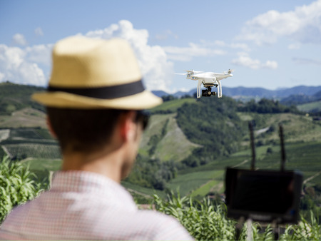 businness: Quadcopter drone for agriculture, technology and security concepts