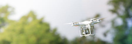 Flying drone in action; photographed on a defocused background. 版權商用圖片