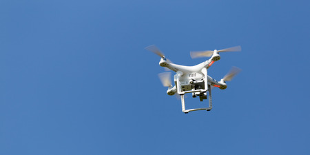 Flying drone, outdoor action on a defocused background. Royalty free image, no logos in the photo. Stock Photo