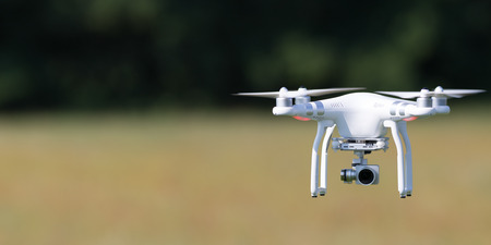 free image: Flying drone in action; photographed on a defocused background. Royalty free image, no logos in the photo. Stock Photo