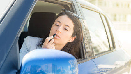 Woman, traffic and car problematic relationship Stock Photo