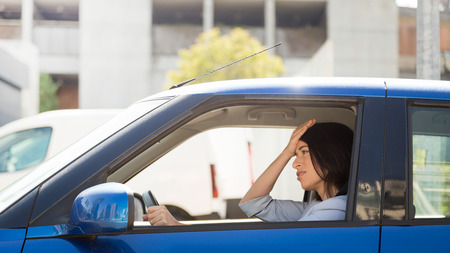 tense: Angry and tense woman stuck in the traffic