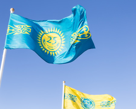 founding: Astana flags on a blue sky, Kazakhstan. Celebration of the founding of the city. Stock Photo