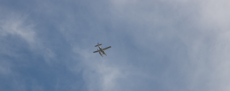 Seaplane flying in the blue sky