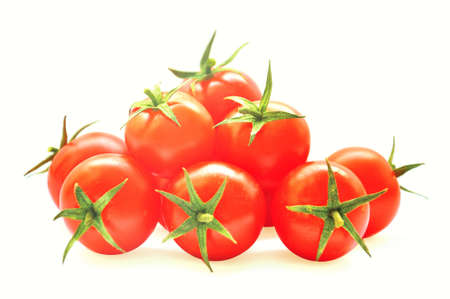 Red cherry tomatos isolated on white
