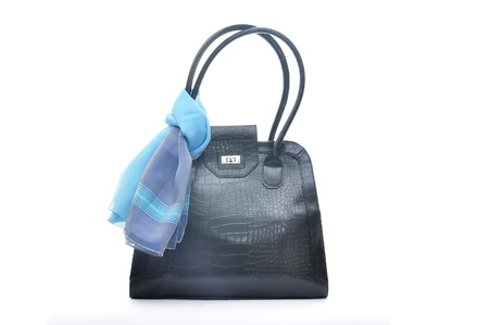 Black handbag with blue silk scarf isolated on white  photo