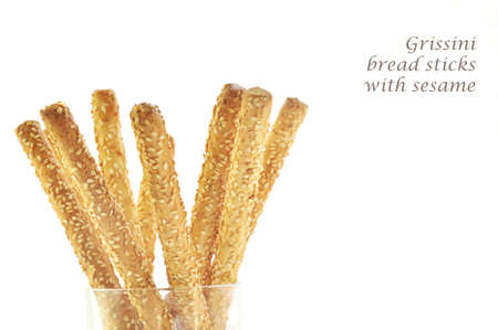breadstick: grissini bread sticks with sesame isolated on white
