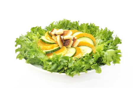 Salad with mandarin  cucumber and toastisolated on white