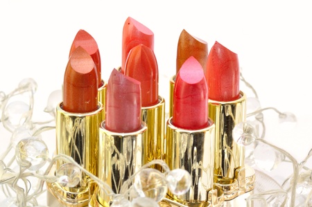 Set of lipsticks decorated with beads isolated on white