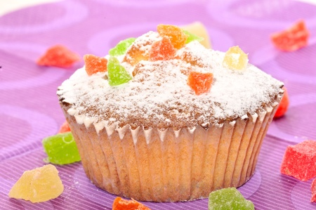 Close up of sugary muffin cupcake with sugar powder and colorful sweets Stock Photo - 13813369