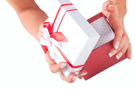 hand with a gift with a red ribbon isolated on white background Stock Photo