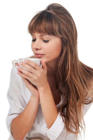 Beautiful young woman enoyoing with coffee cup photo