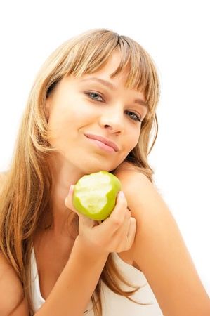 Happy healthy girl with green apple isolated on white photo