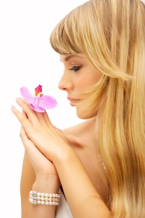 Beautiful young woman with flower and long blond hair photo