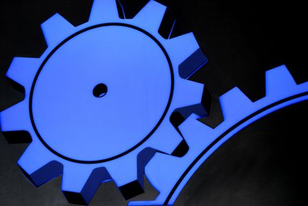 neon sign showing blue cogwheels working together photo