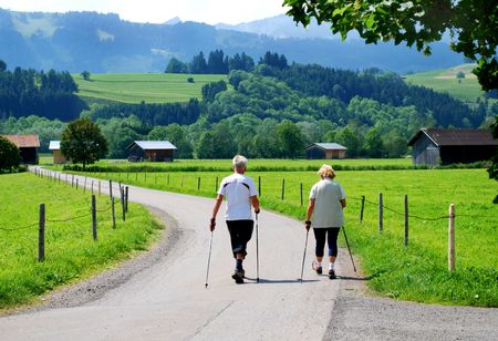 elderly people nordic walking in the bavarian alps germany photo